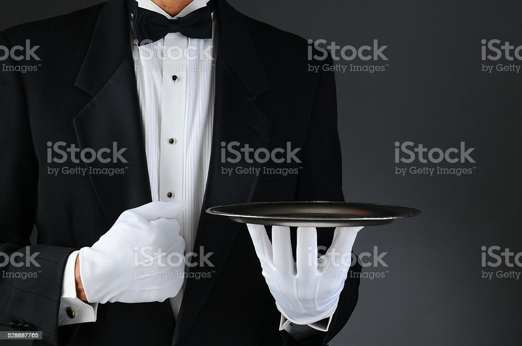 Waiter With Silver Tray stock photo