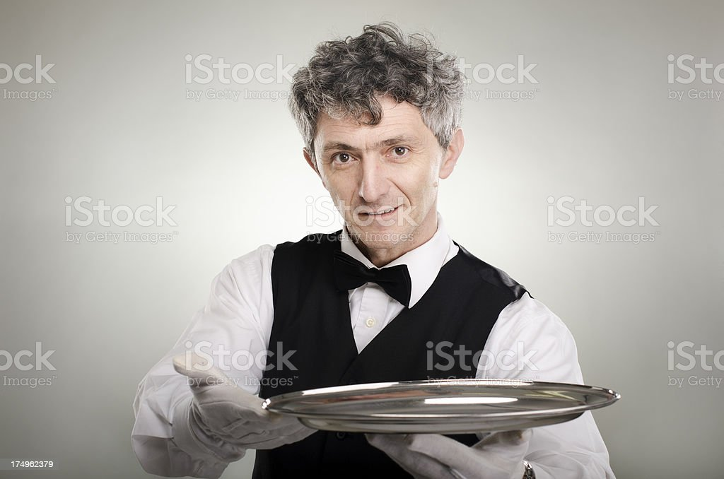 Waiter with the plate royalty-free stock photo