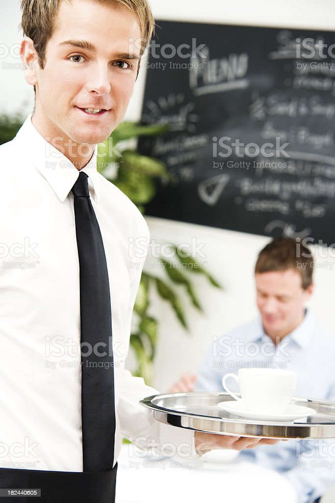 Waiter with Tie and Male Customer in the Background royalty-free stock photo