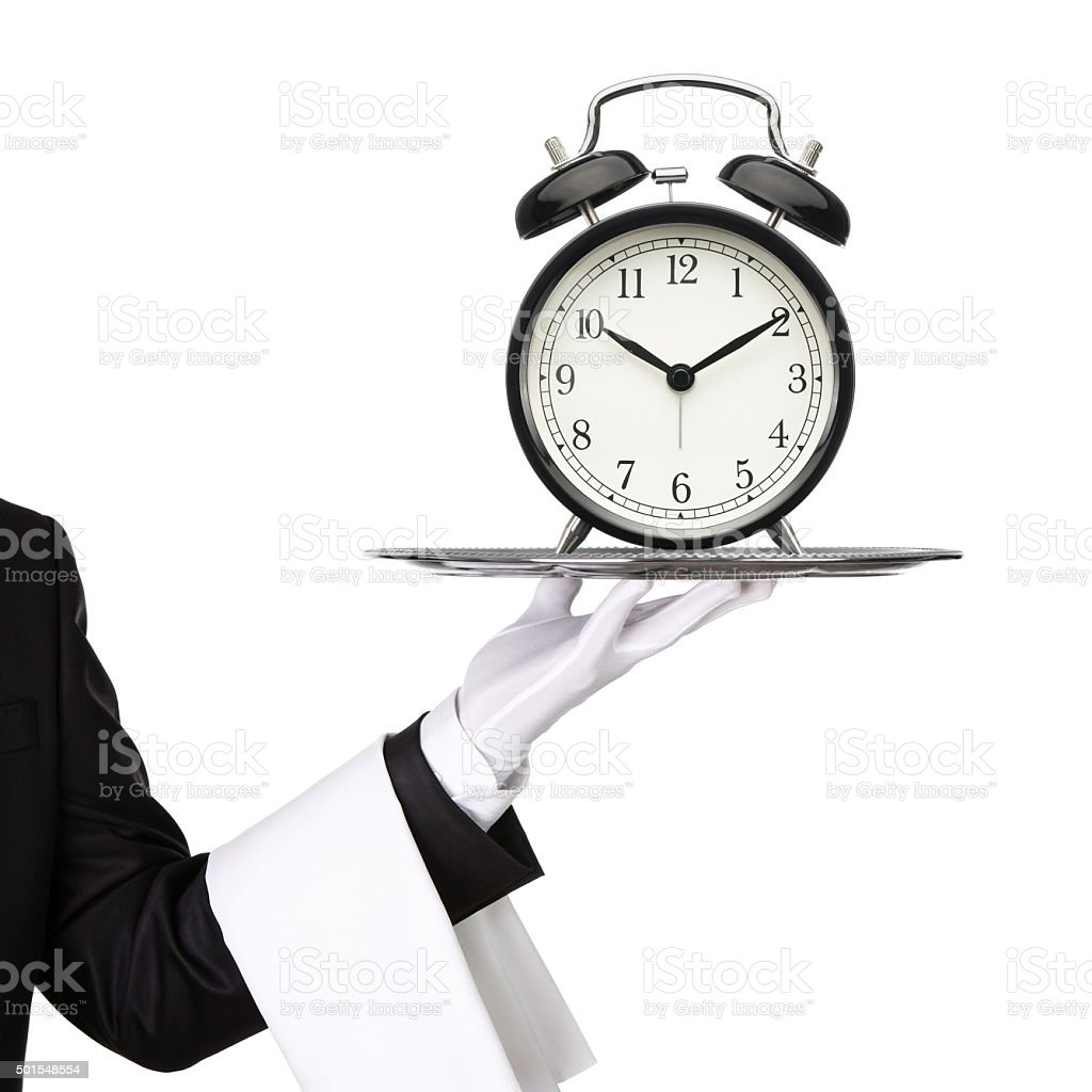 Waiter with tray and a clock stock photo