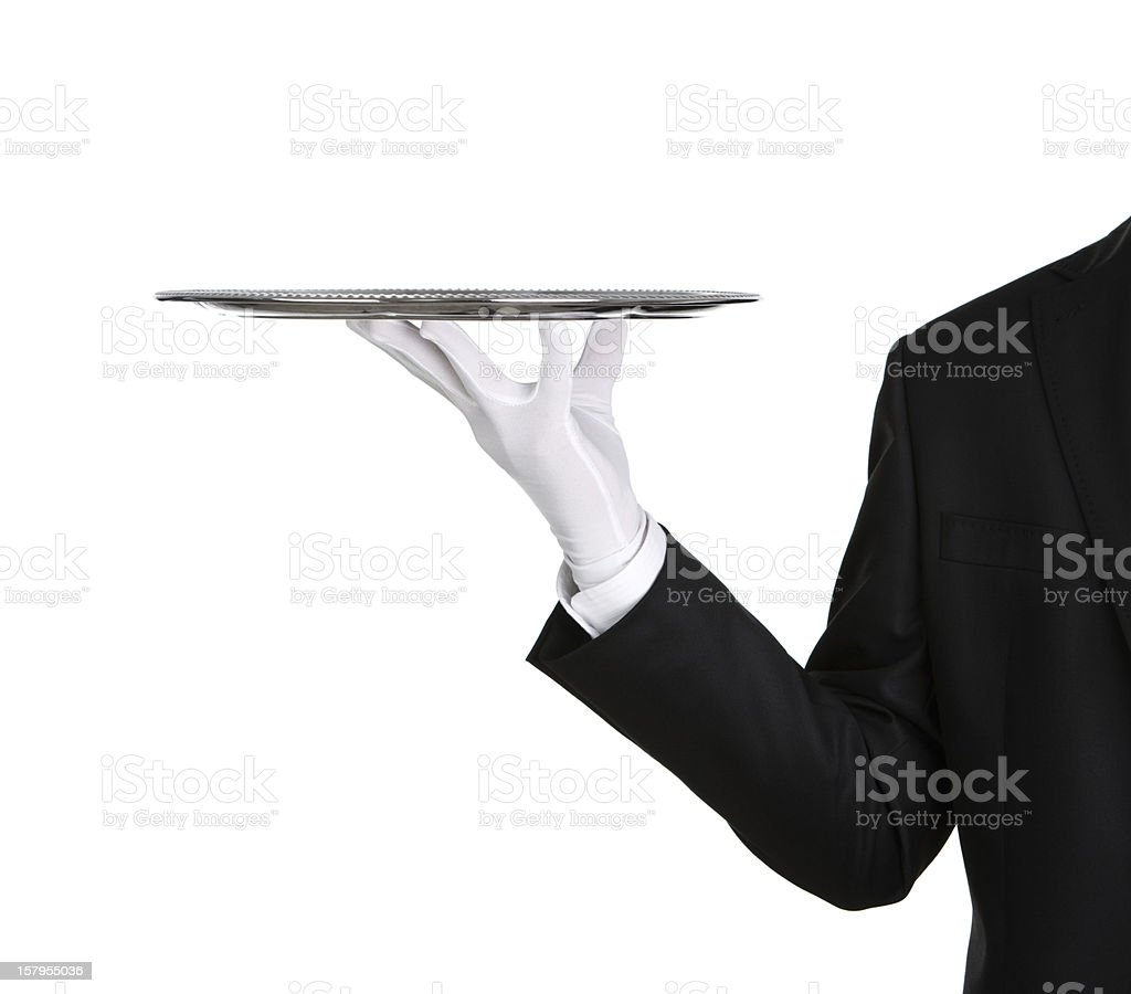 A waiter's arm holding an empty silver platter stock photo