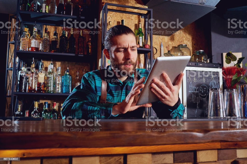 Waiters, bartenders barista work with the tablet in cafe bar res stock photo