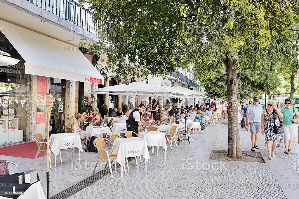 Waiters serving drink in street cafe stock photo