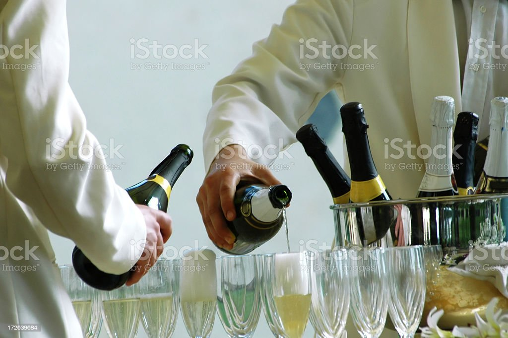 waiters serving royalty-free stock photo