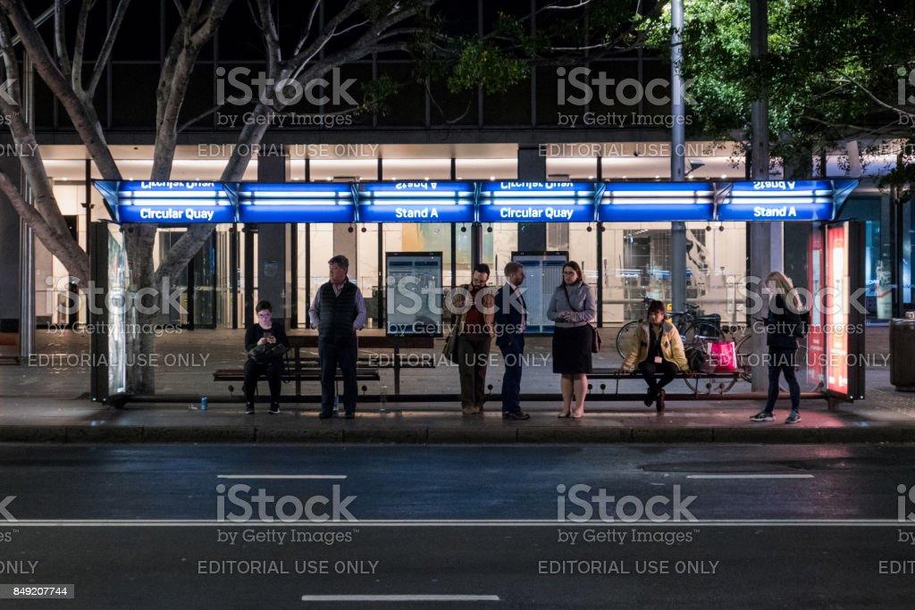 Waiting at Bus Stop stock photo
