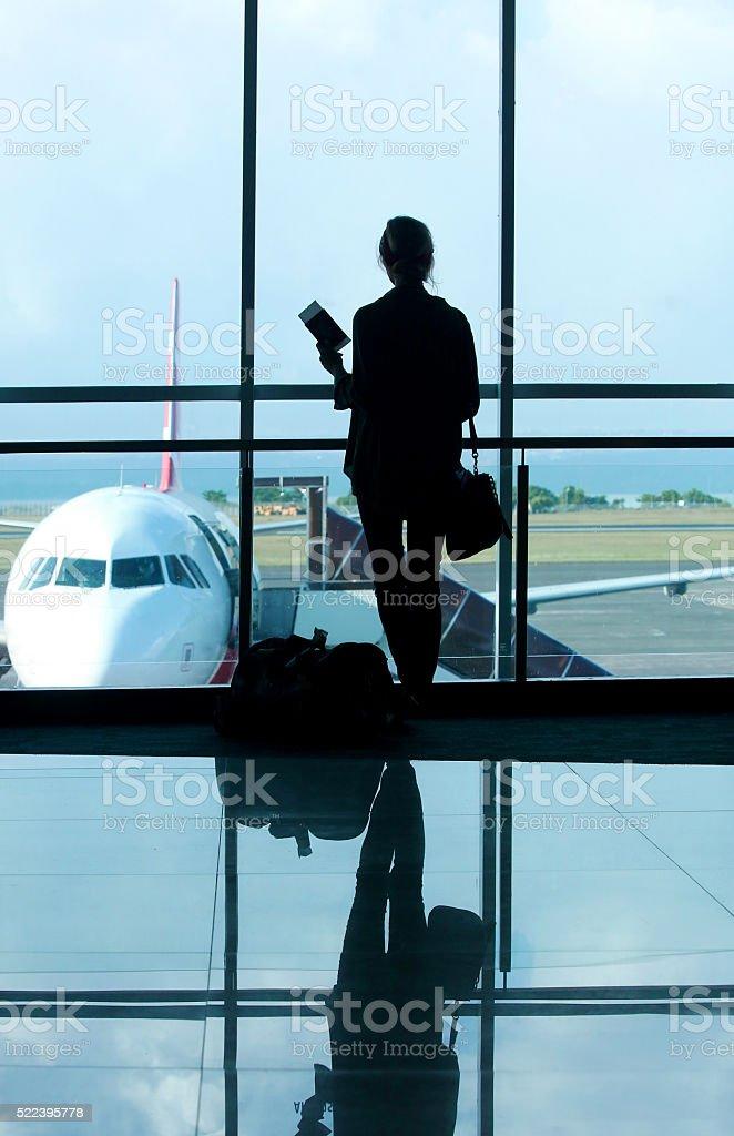 Waiting at the airport terminal stock photo