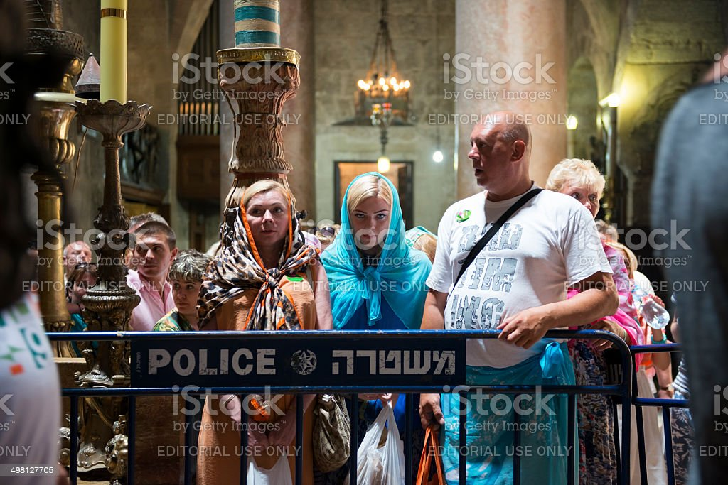 Waiting at the Tomb of Jesus in Jerusalem's Holy Sepulchre stock photo
