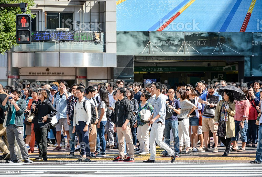 Waiting at Tokyo's Shibuya Pedestrian Crossing stock photo