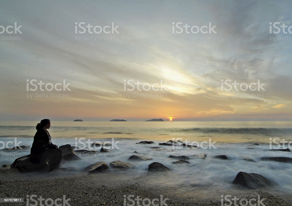 Waiting by the sea stock photo