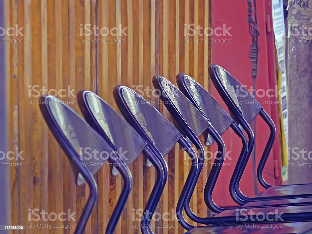 Waiting chairs of Perforated sheet at a Bus stop stock photo