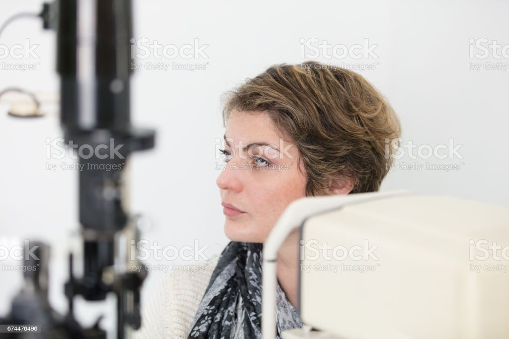 Waiting for eye exam stock photo