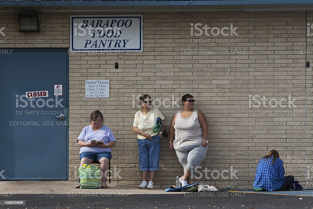 waiting for food pantry to open stock photo