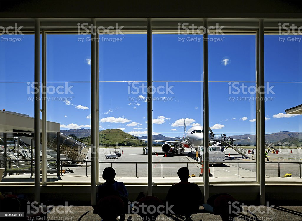 Waiting for the flight in airport hall royalty-free stock photo
