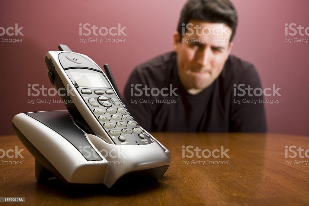 Waiting for the phone, needing to pee royalty-free stock photo