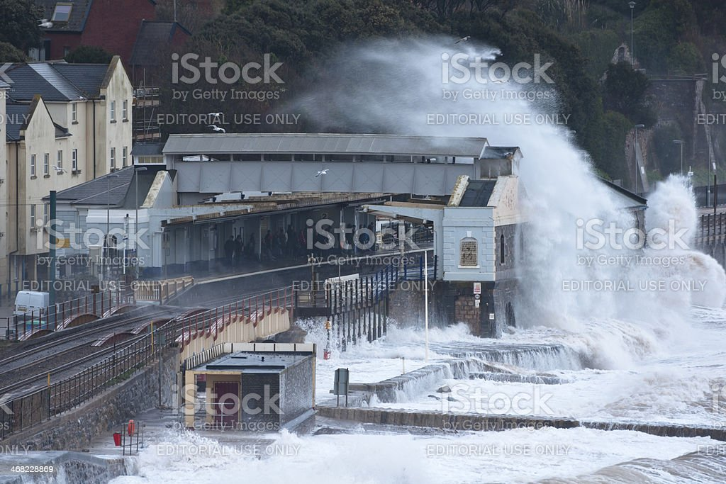 Waiting for the train during storm at Dawlish railway station stock photo