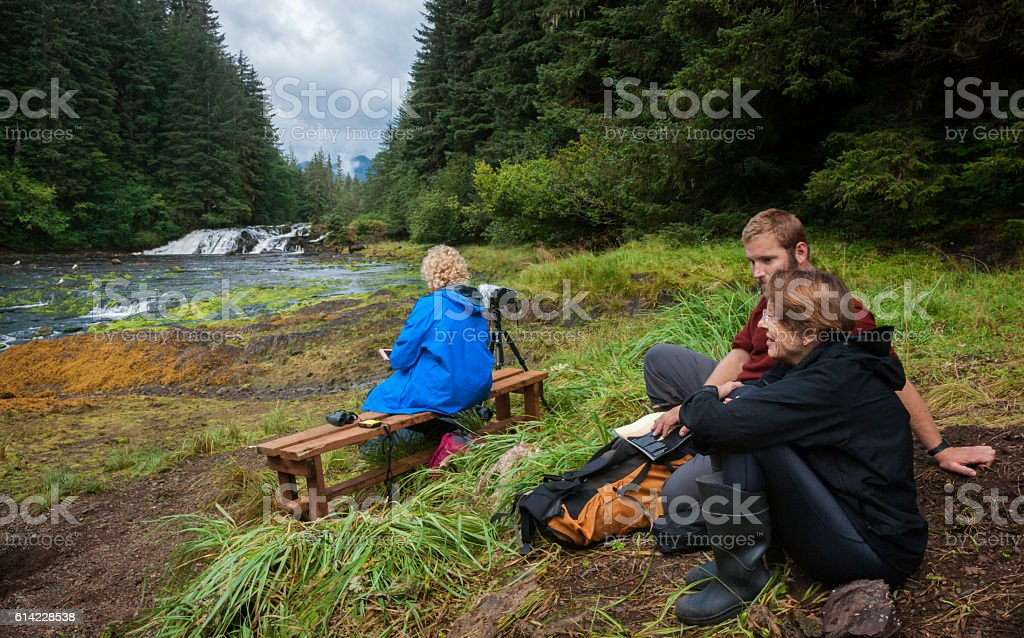 Waiting for wildlife at waterfall stock photo