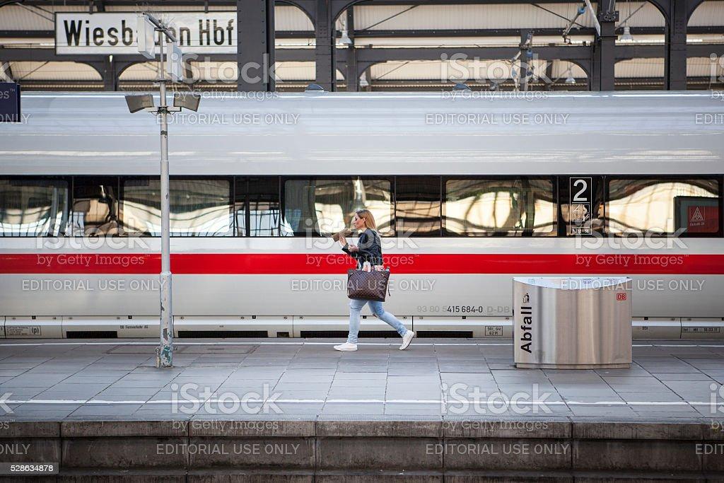 Waiting ICE train - female passenger stock photo