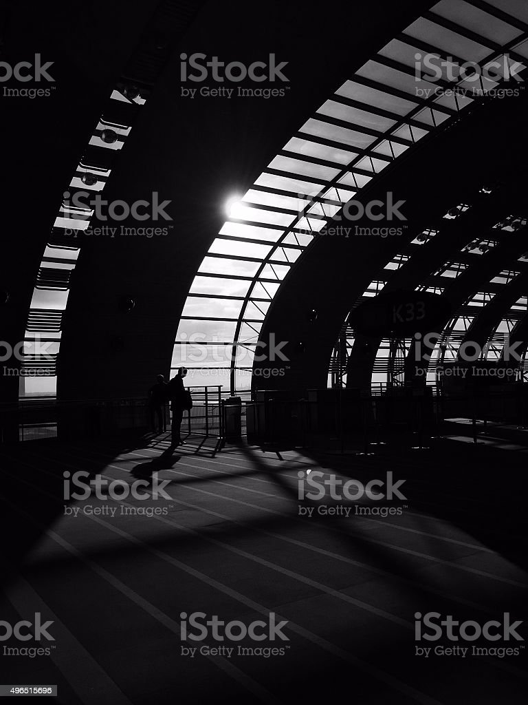 waiting in room sunlit windows black and white silhouette stock photo