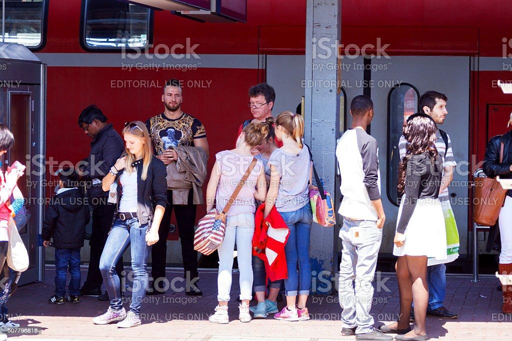 Waiting people on platform of station Dortmund stock photo