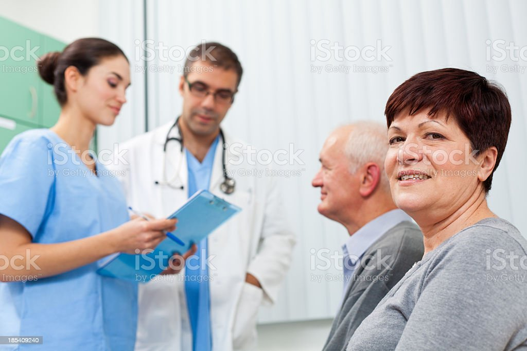 Waiting room - doctor, nurse and patients stock photo