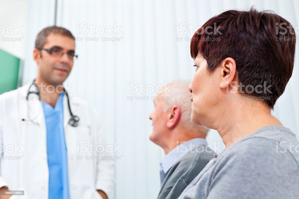 Waiting room - Doctor talking with patients royalty-free stock photo