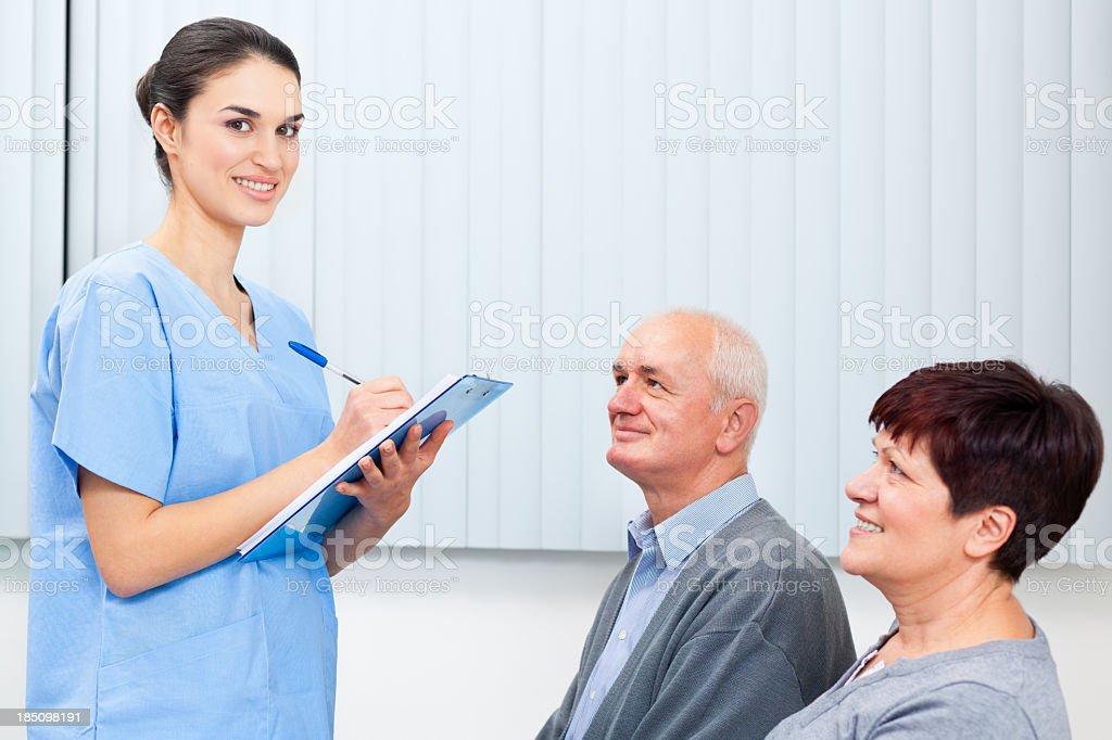 Waiting room - Nurse filling form royalty-free stock photo