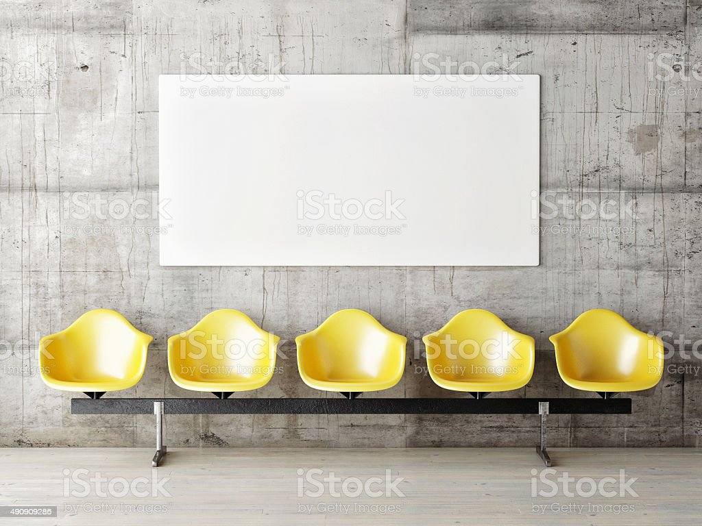 Waiting room with poster, five yellow chairs stock photo