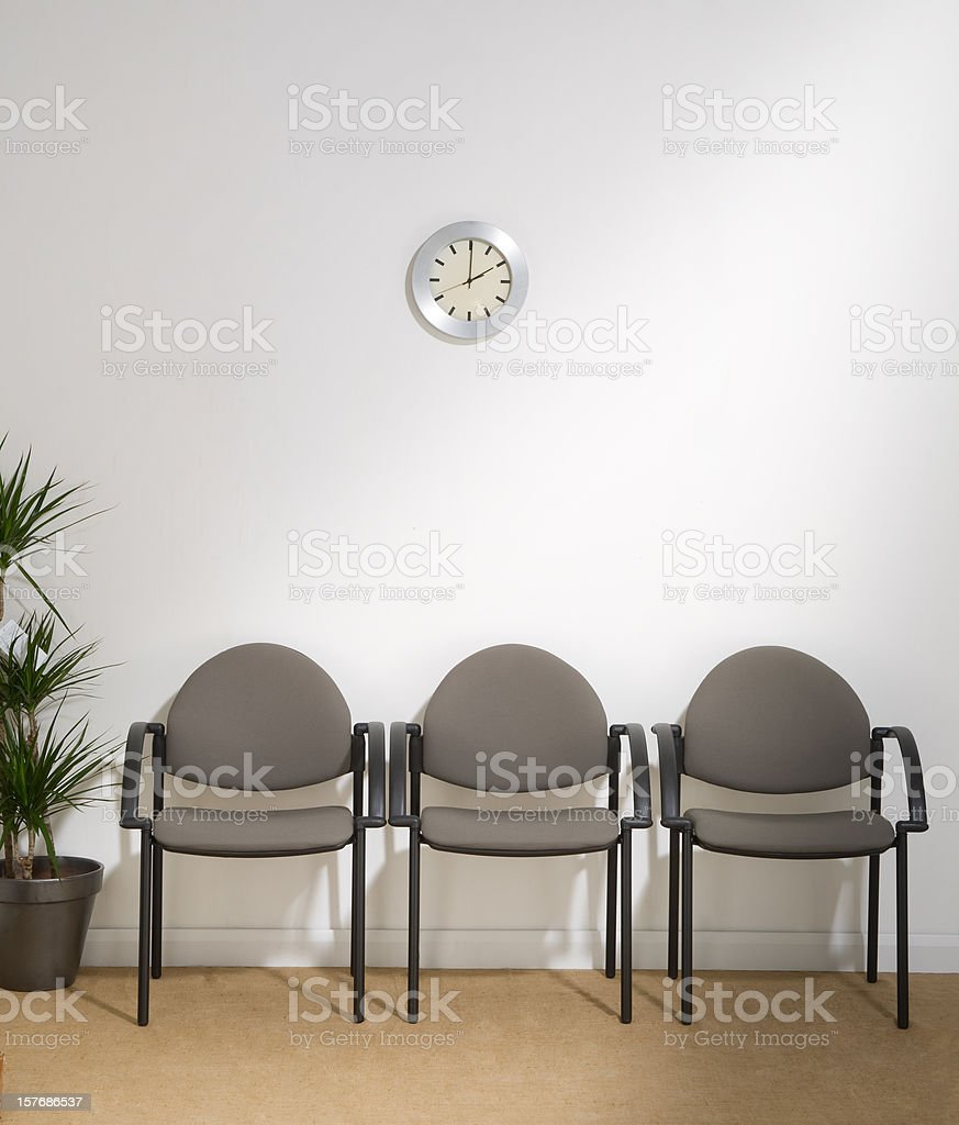 Waiting Room with Three Chairs stock photo