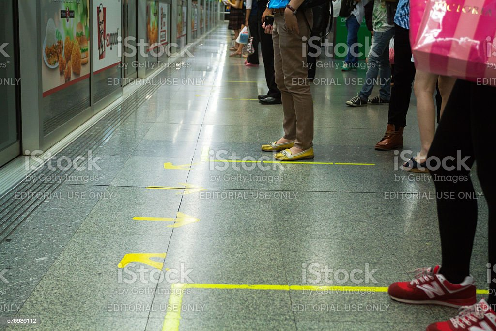Waiting thai commuters in MRT station stock photo