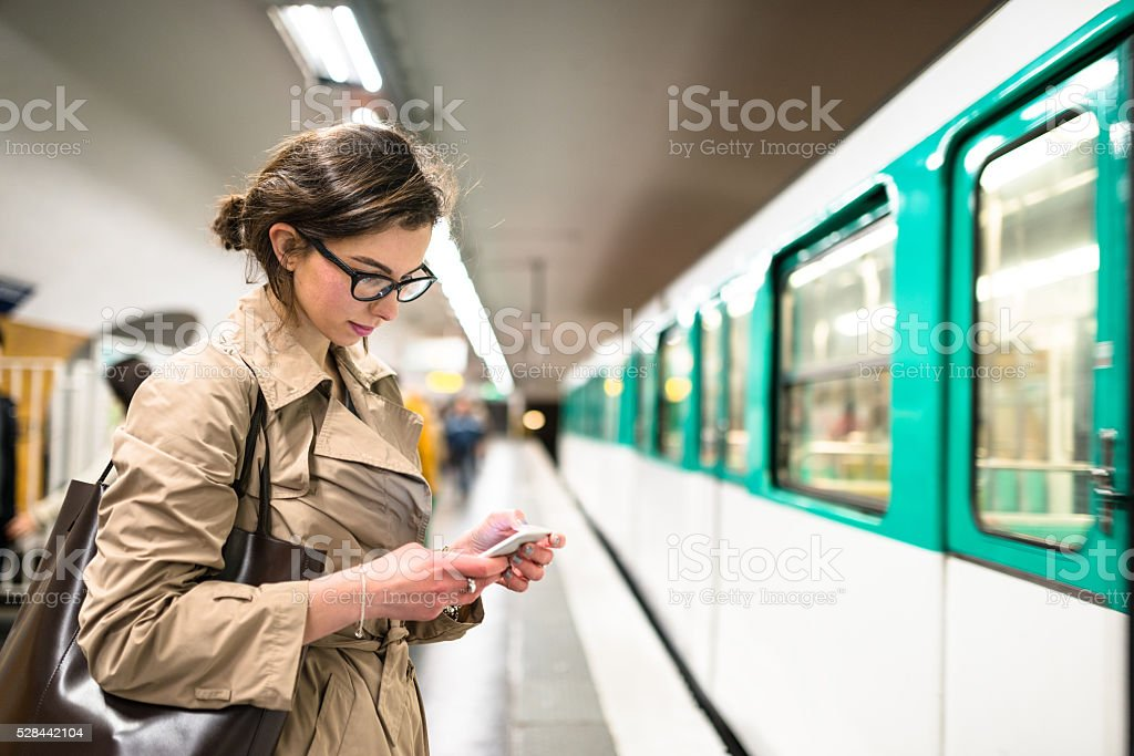 waiting the train in paris subway station stock photo
