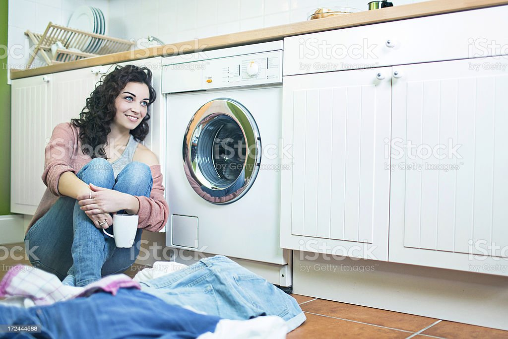 Waiting to load more clothes in the washing machine royalty-free stock photo