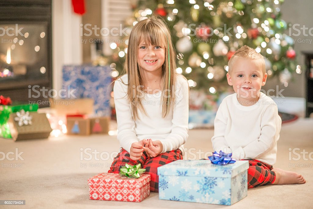 Waiting to Open Presents on Christmas Morning stock photo