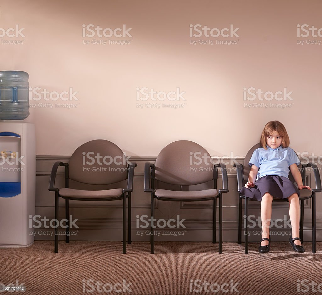 waiting to see the principal stock photo