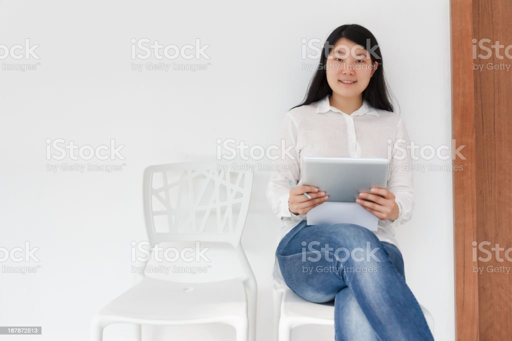 Waiting with a tablet pc royalty-free stock photo