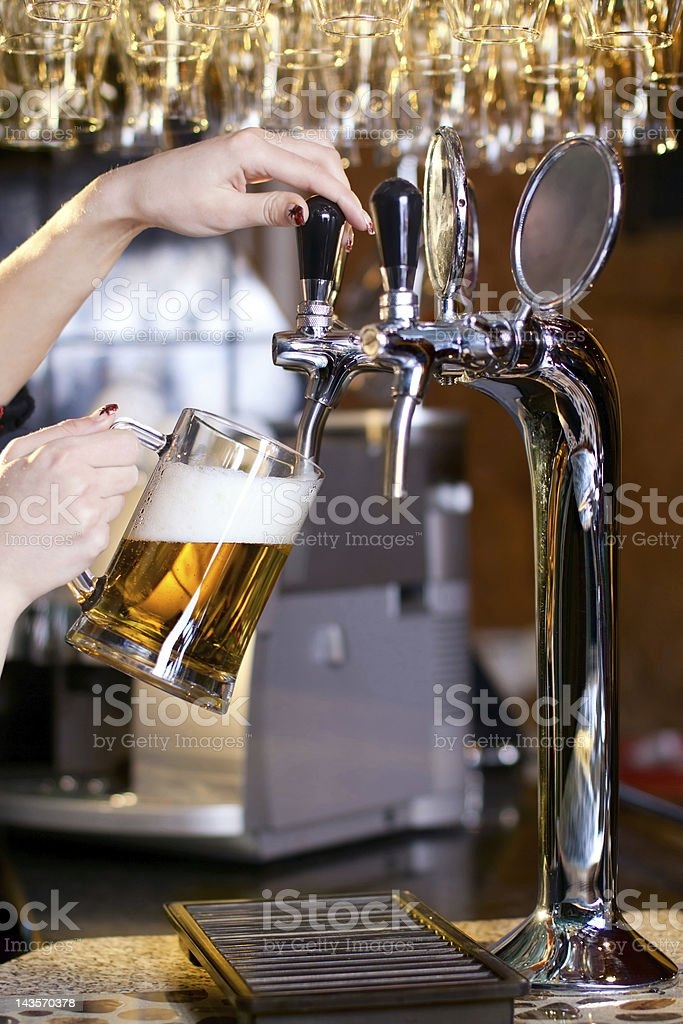waiting woman pouring beer royalty-free stock photo