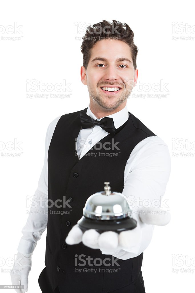 Waitperson Holding Service Bell stock photo