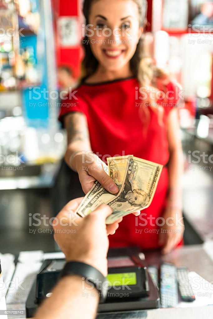 waitress and cashier receiving money at the bar counter stock photo