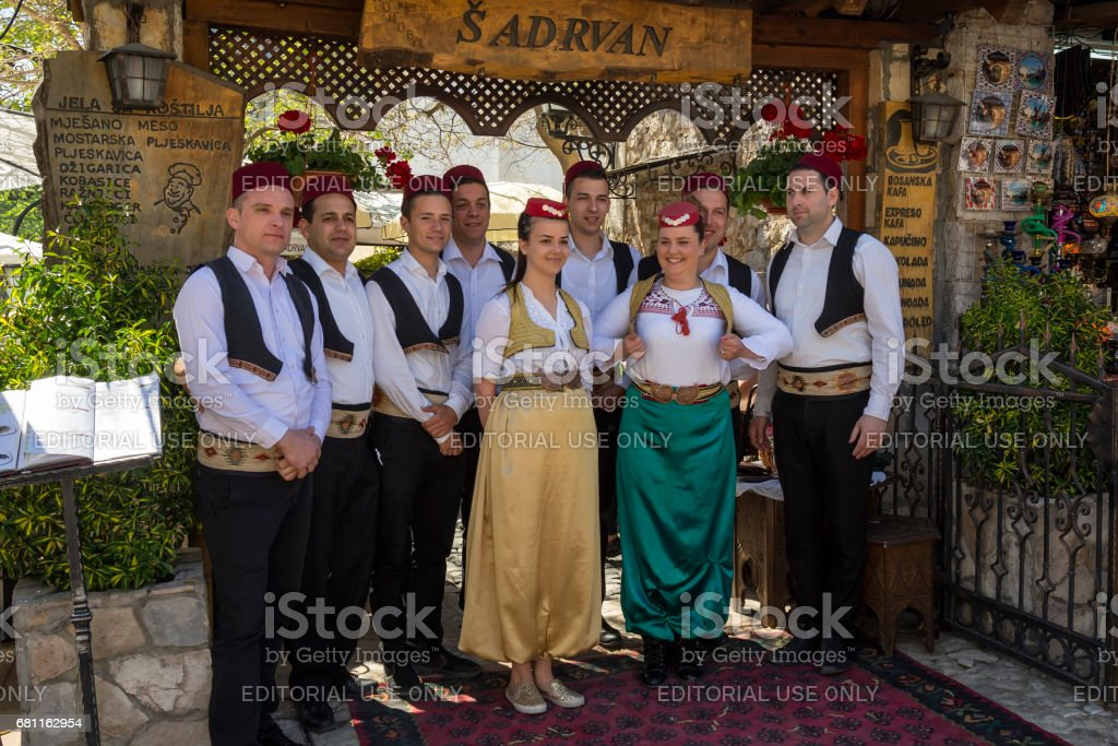 Waitress and waiters posing in front of Sadrvan restaurant stock photo