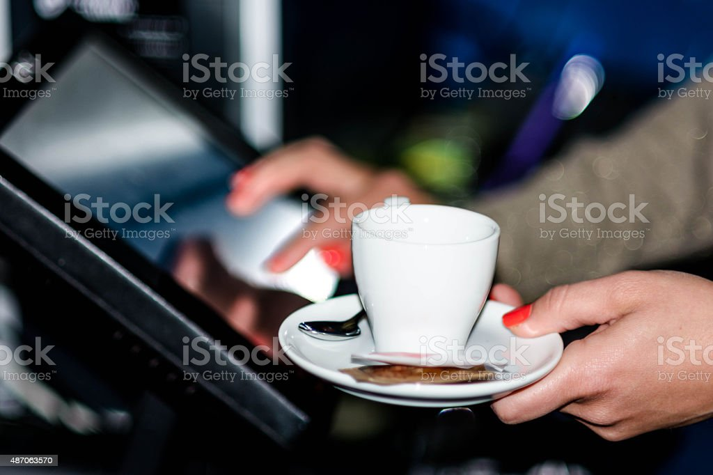 Waitress at the point of sale terminal stock photo
