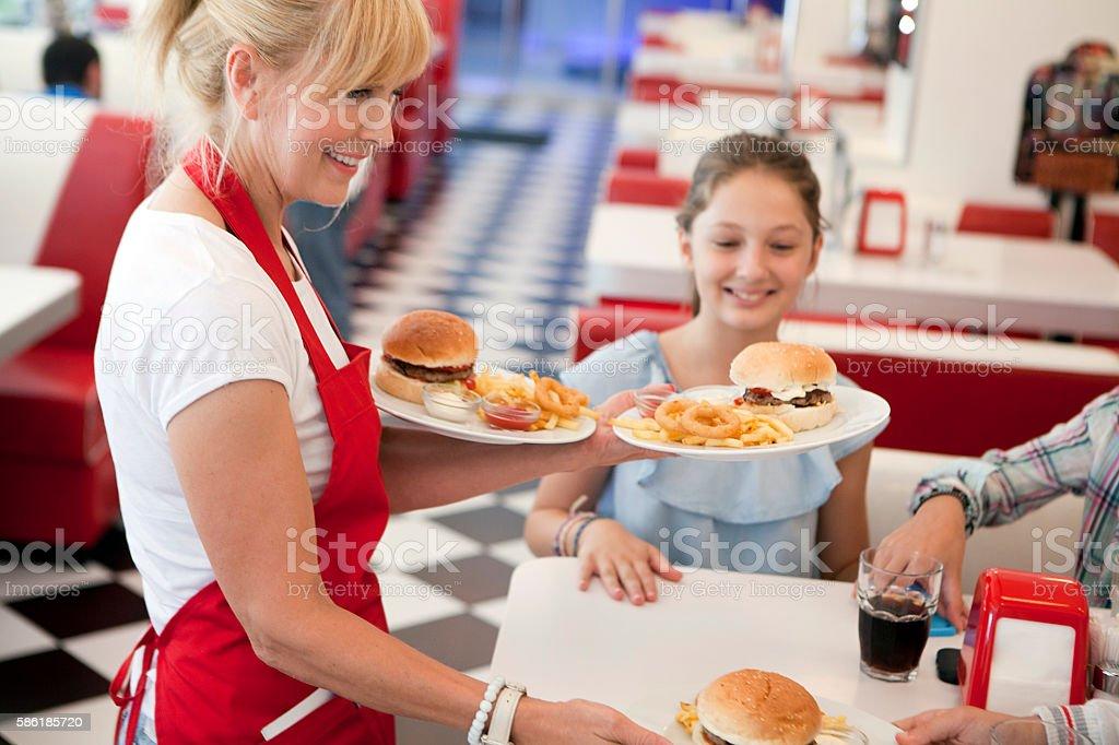 Waitress bringing meal stock photo