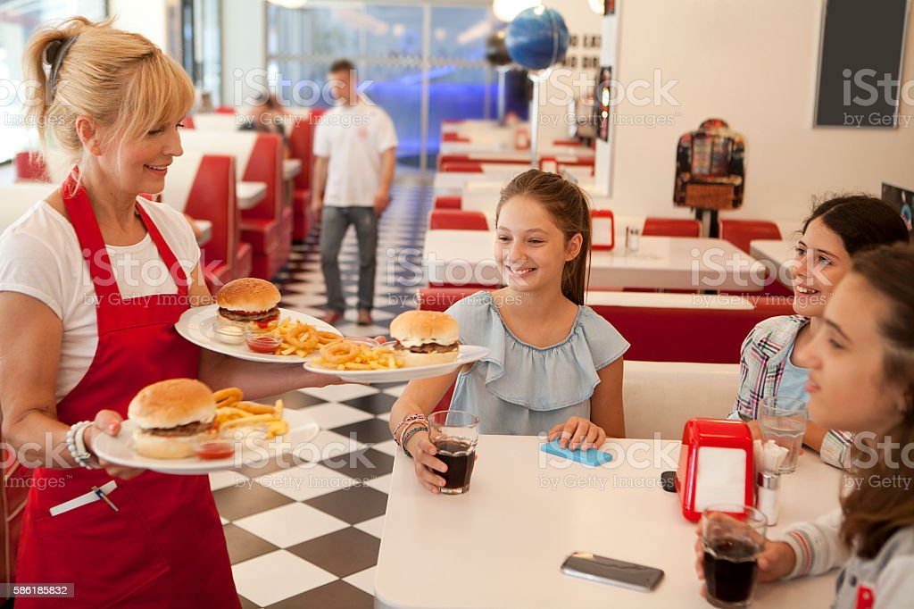 Waitress bringing meal stock photo