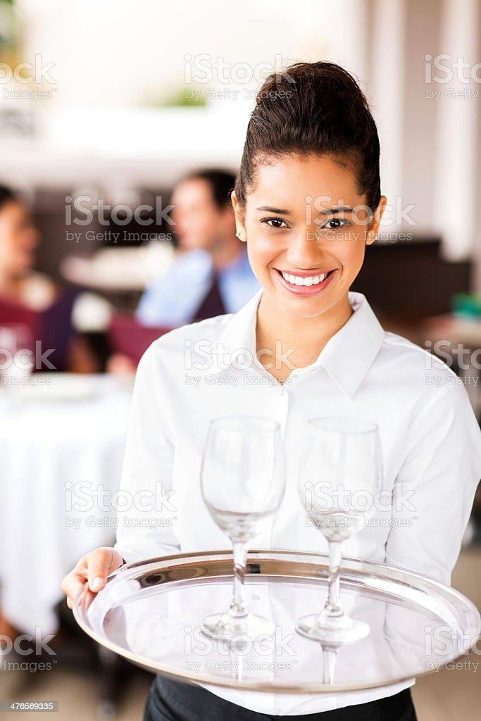 Waitress Carrying Tray Of Empty Wineglasses At Restaurant royalty-free stock photo