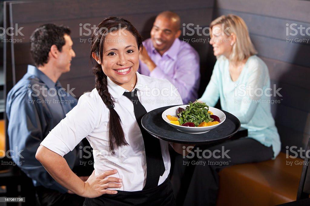 Waitress carrying tray with salad royalty-free stock photo
