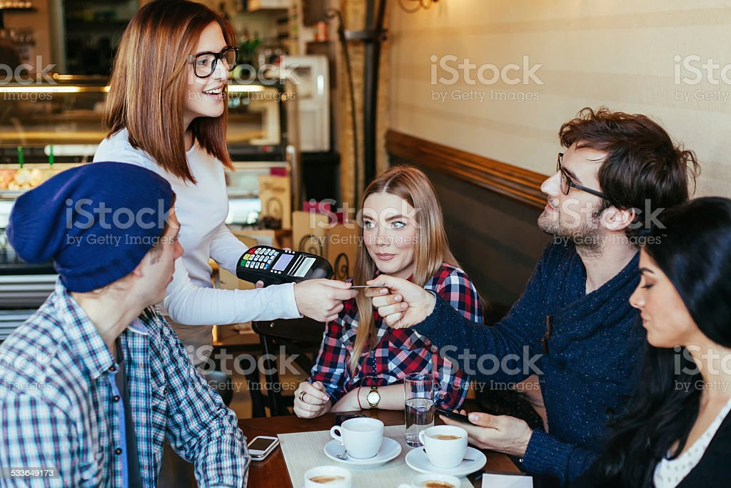 Waitress Charging Customers Bill stock photo