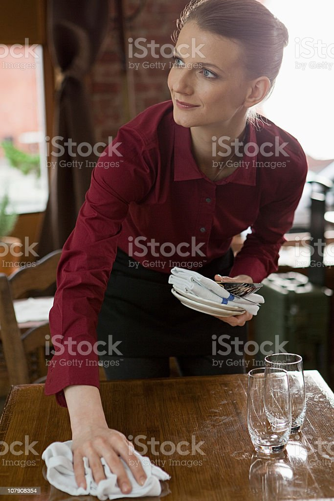 Waitress clearing table royalty-free stock photo