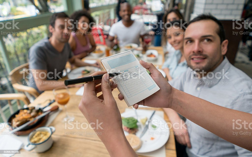 Waitress confirming an order at a restaurant stock photo