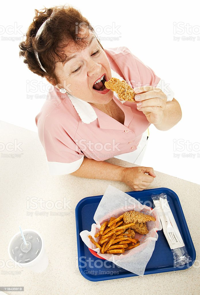 Waitress Eating Fast Food royalty-free stock photo