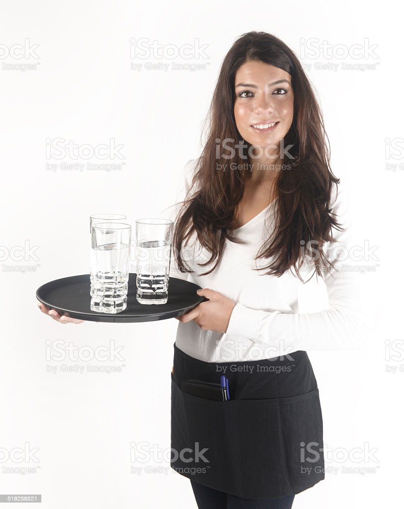 waitress holding tray full of water glasses stock photo