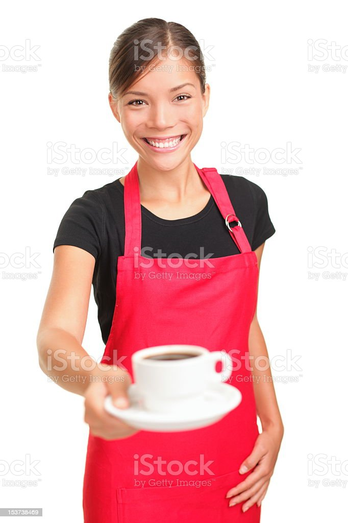 A waitress in a red apron serving a cup of coffee royalty-free stock photo