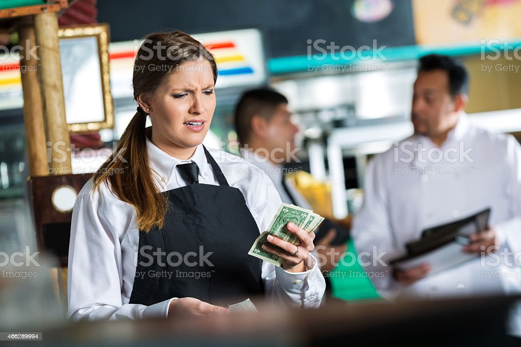 Waitress in Tex-Mex restaurant disappointed in small tip from customer stock photo